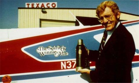 Figure 7. Calvin Pitts holding Amelia's Earhart's actual thermos from her solo Atlantic Crossing in 1932 during his successful world flight in 1981 (42).